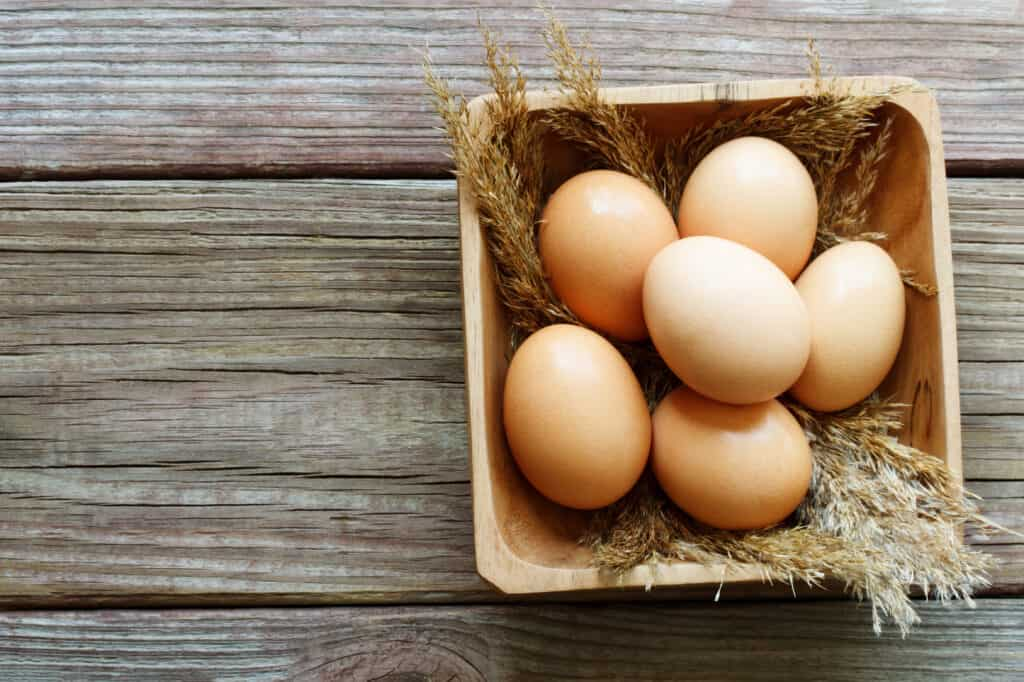 Light Brown eggs in wooden bowl